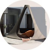 """Produktfoto - Das Cacoon Songo in der Farbe """"Erde"""" - fotografiert mit Blick auf den Eingang bzw. durch die Eingänge - darin liegen Kissen und eine Decke"""